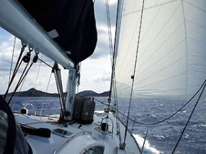UNder sail approaching dive site of RMS Rhona